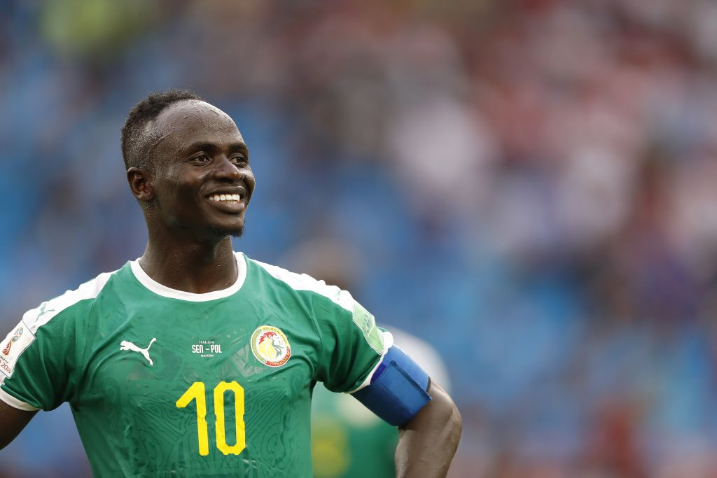 Liverpool attacker Sadio Mane reacts to Kalidou Koulibaly banner