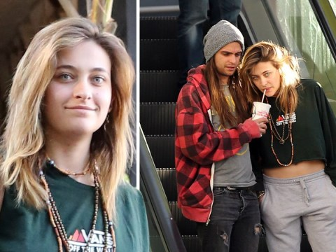 Paris Jackson smiles and takes sip from boyfriend's drink as she's seen for first time since hospitalisation