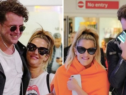 Caroline Flack 'feeling the love' as she arrives home from Dubai holiday arm-in-arm with friend