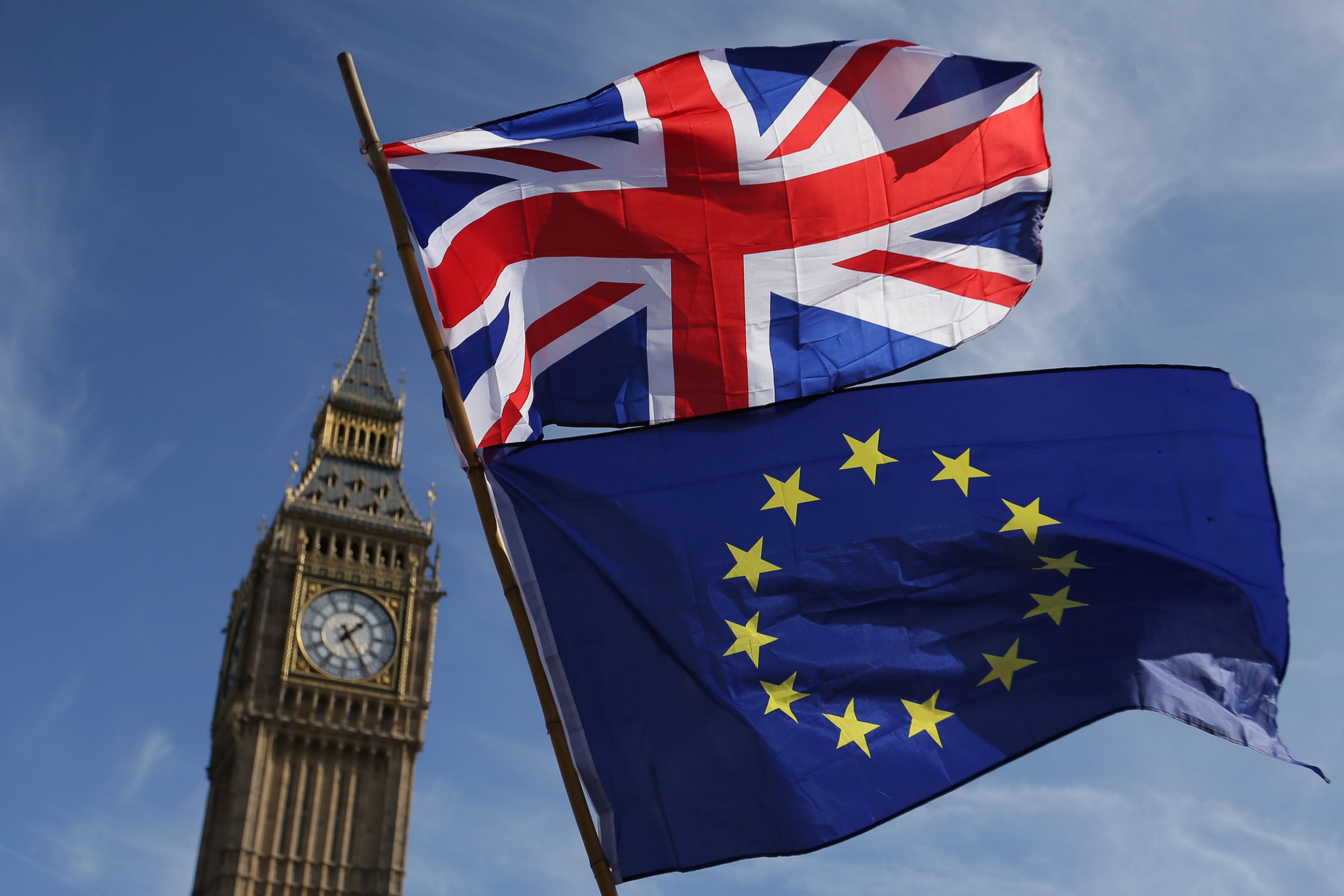 (FILES) In this file photo taken on March 25, 2017 An EU flag and a Union flag held by a demonstrator is seen with Elizabeth Tower (Big Ben) and the Houses of Parliament as marchers taking part in an anti-Brexit, pro-European Union (EU) enter Parliament Square in central London on March 25, 2017, ahead of the British government's planned triggering of Article 50 next week. - Britain's battle over Brexit resumes on January 7, 2019 when parliament returns from its Christmas break to debate and -- most likely -- defeat Prime Minister Theresa May's unpopular EU divorce deal. (Photo by Daniel LEAL-OLIVAS / AFP)DANIEL LEAL-OLIVAS/AFP/Getty Images
