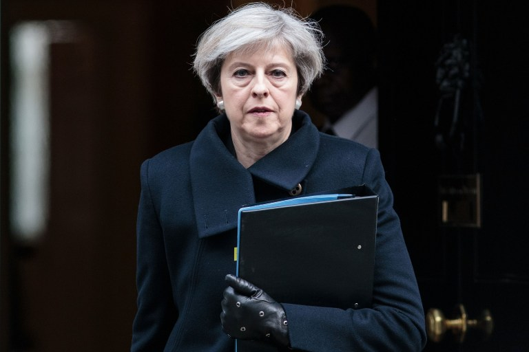 """LONDON, ENGLAND - MARCH 23: Prime Minister Theresa May leaves Downing Street on March 23, 2017 in London, England. The British Prime Minister Theresa May spoke last night after a terrorist attack took place in Westminster, saying Parliament would meet as normal today and """"We will come together as normal"""". PC Keith Palmer and three others lost their lives in the attack and the perpetrator was shot dead by police. (Photo by Jack Taylor/Getty Images)"""