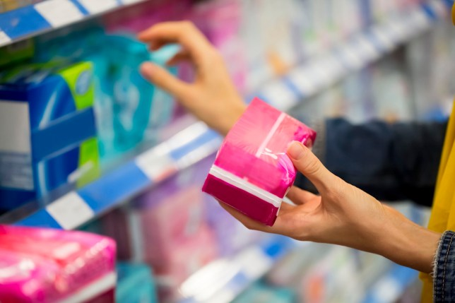 A woman choosing sanitary products