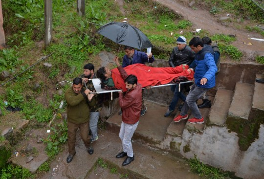 An injured man is carried on a stretcher at a hospital in the Indian Kashmir frontier town of Mendhar on March 2, 2019, after being wounded in his home when it was struck by a mortar shell that his family said was fired by Pakistan troops along the Line of Control (LoC) that divides Kashmir between India and Pakistan. - A video of an Indian pilot freed from Pakistani custody in which he praises Pakistan's army March 2 sparked anger in India and concern that it was recorded under duress. Violence meanwhile continued to rage in Kashmir, with both sides firing mortars and artillery over the Line of Control (LoC) frontier, killing four civilians on the Indian side and one in Pakistan-administered Kashmir. (Photo by SAJJAD HUSSAIN / AFP)SAJJAD HUSSAIN/AFP/Getty Images