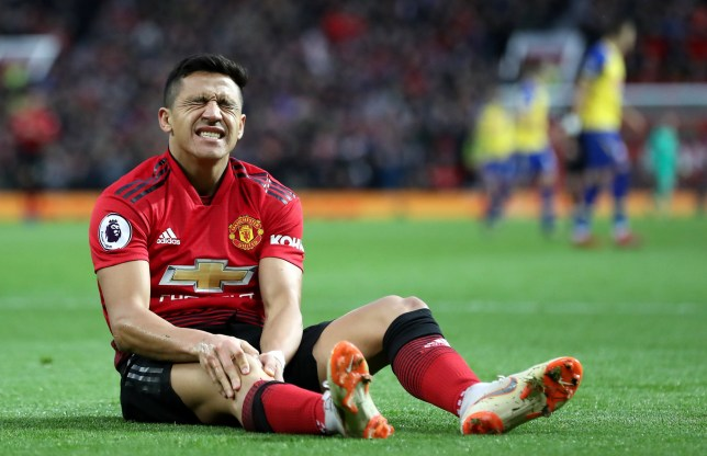 """Manchester United's Alexis Sanchez reacts to an injury during the Premier League match at Old Trafford, Manchester. PRESS ASSOCIATION Photo. Picture date: Saturday March 2, 2019. See PA story SOCCER Man Utd. Photo credit should read: Martin Rickett/PA Wire. RESTRICTIONS: EDITORIAL USE ONLY No use with unauthorised audio, video, data, fixture lists, club/league logos or """"live"""" services. Online in-match use limited to 120 images, no video emulation. No use in betting, games or single club/league/player publications"""