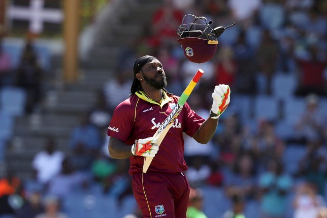West Indies' Chris Gayle celebrates after he scored half a century against England during the fifth One Day International cricket match at the Daren Sammy Cricket Ground in Gros Islet, St. Lucia, Saturday, March 2, 2019. (AP Photo/Ricardo Mazalan)