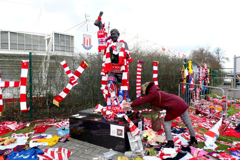 A general view of a fan adding to the memorial surrounding the Gordon Banks statue outside the bet365 Stadium, Stoke. PRESS ASSOCIATION Photo. Picture date: Monday March 4, 2019. England 1966 World Cup winning goalkeeper Banks, who made 194 appearances across six years for Stoke City, died last month at the age of 81. See PA story SOCCER Banks. Photo credit should read: Aaron Chown/PA Wire
