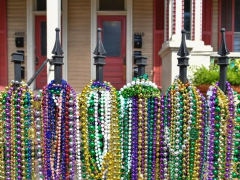 What is the purpose of Mardi Gras beads and where can you buy them?