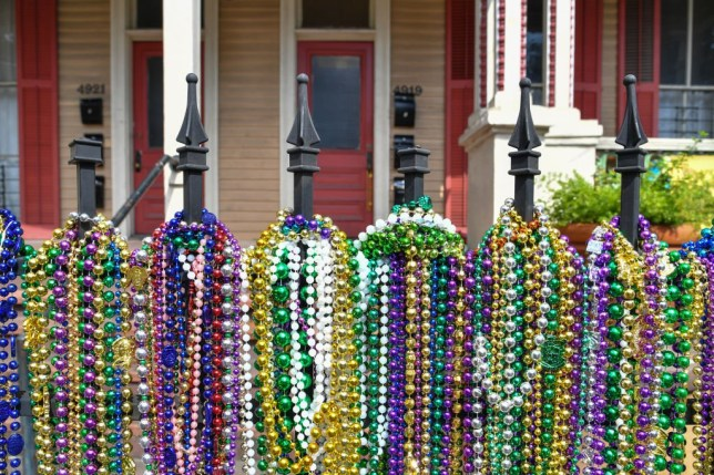 mardi gras beads decorating a street in new orleans