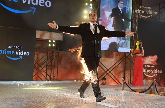 Indian Bollywood actor Akshay Kumar performs a fire stunt during the announcement of the upcoming series 'The End' of Amazon Prime Video, in Mumbai on March 5, 2019. (Photo by Sujit Jaiswal / AFP)SUJIT JAISWAL/AFP/Getty Images