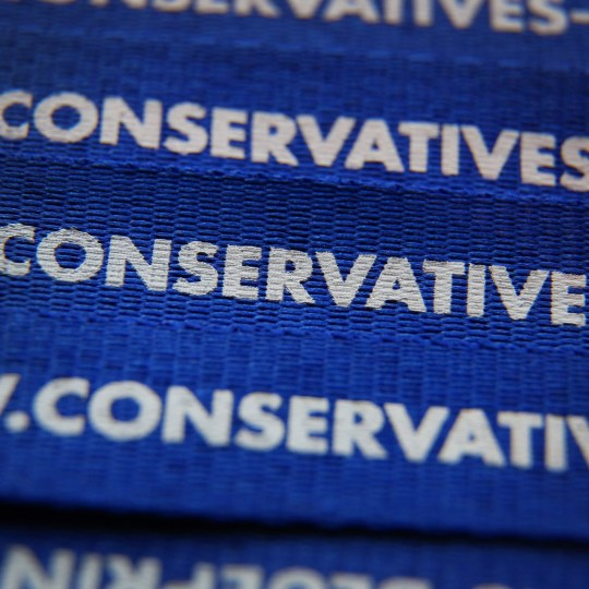 BIRMINGHAM, ENGLAND - SEPTEMBER 29: A close up images shows part of a web address on a security badge lanyard at the Conservative party conference on September 29, 2014 in Birmingham, England. The governing Conservative party are holding their yearly conference over four days. (Photo by Peter Macdiarmid/Getty Images)