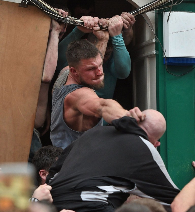 Players grapple with one another as they take part in the Atherstone Ball Game in Atherstone, Warwickshire. The game honours a match played between Leicestershire and Warwickshire in 1199, when teams used a bag of gold as a ball, and which was won by Warwickshire. PRESS ASSOCIATION Photo. Picture date: Tuesday March 5, 2019. Photo credit should read: Joe Giddens/PA Wire