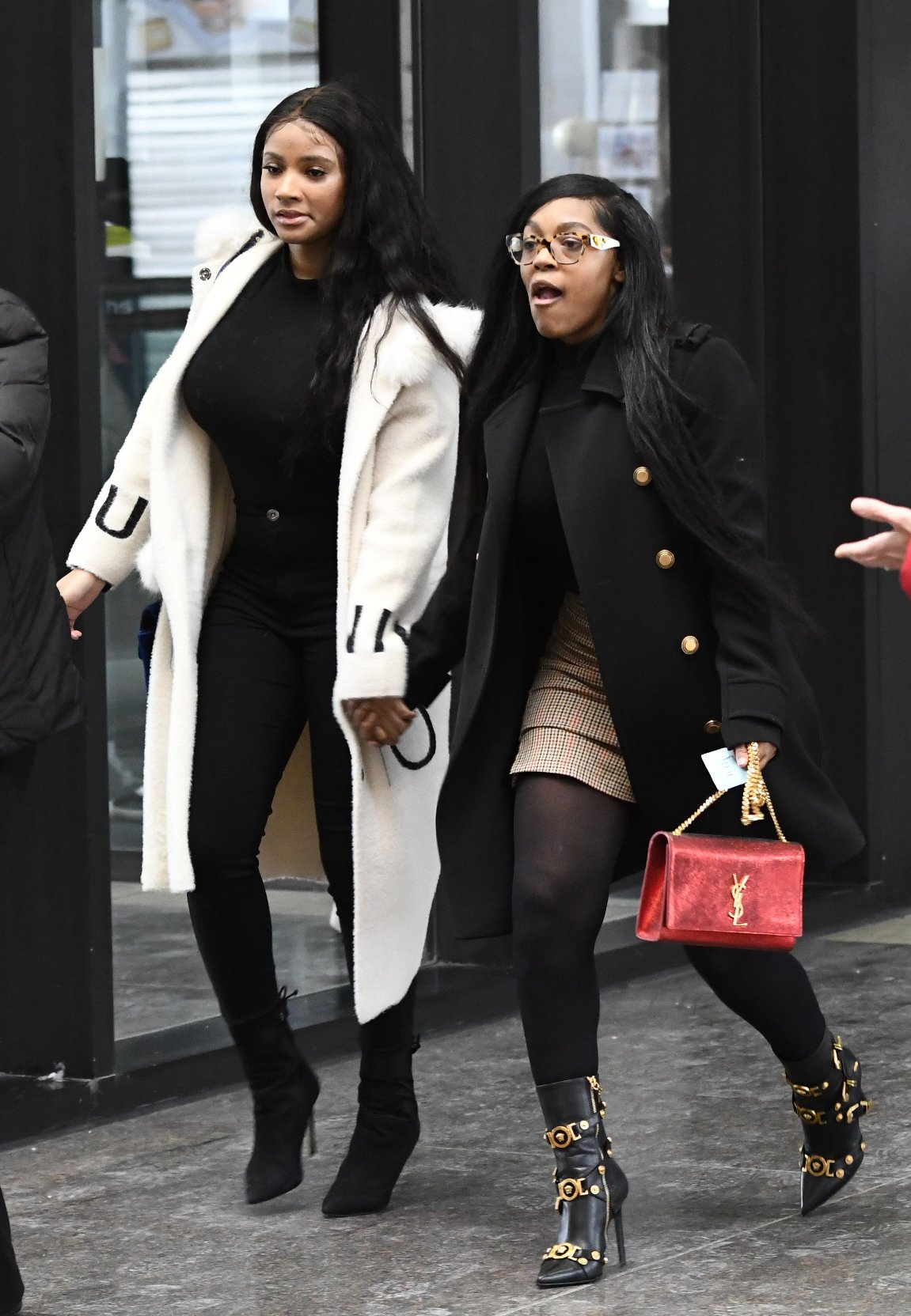 """In this Feb. 23, 2019, photo, Joycelyn Savage, left, and Azriel Clary walk into the Leighton Criminal Courthouse in Chicago for R&B star R. Kelly's first court appearance on sexual abuse charges. """"CBS This Morning"""" interviews with the two women who live with Kelly ??? Savage and Clary ??? will air Thursday, March 7. (AP Photo/Matt Marton)"""