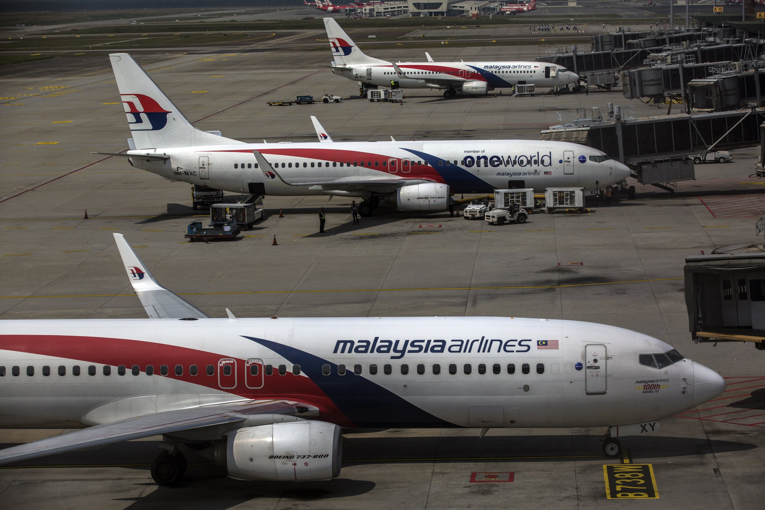 epa07421432 Malaysia Airlines aircraft are seen from the viewing gallery at the Kuala Lumpur International Airport in Sepang, Selangor, Malaysia, 08 March 2019. Malaysia Airlines flight MH370 went missing on its way from Kuala Lumpur to Beijing with the loss of all 239 people on board on 08 March 2014. EPA/AHMAD YUSNI
