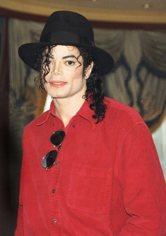 Michael Jackson poses at a press conference before a date on his HIStory world tour in 1996. (Photo by Phil Dent/Redferns)