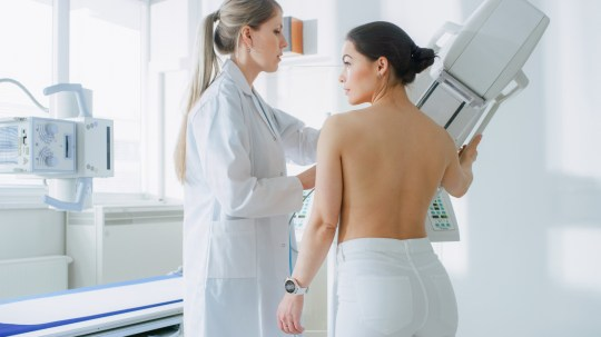 In the Hospital, Mammography Technologist / Doctor adjusts Mammogram Machine for a Female Patient. Friendly Doctor Explains Importance of Breast Cancer Prevention Screening. Modern Hospital.; Shutterstock ID 1130966441; Purchase Order: -