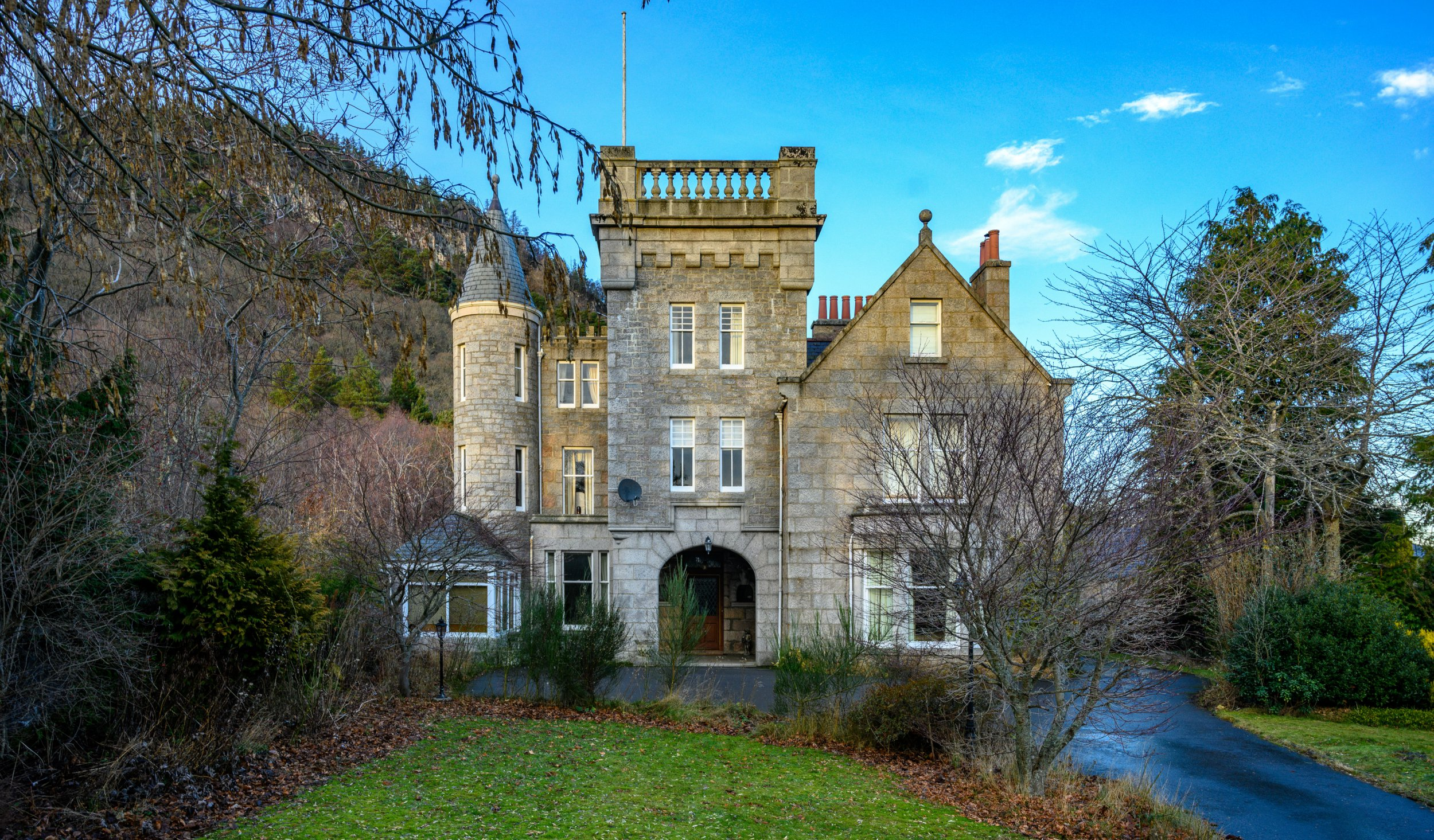 MERCURY PRESS. Aberdeenshire, UK. 11/3/19. Pictured: Craigendarroch House in Aberdeenshire. A Scottish property - neighbouring the Balmoral Estate owned by the royal family - has gone up for sale and its a spitting image of the monarchs favourite home. Craigendarroch House, a grand baronial style home in Ballater, Aberdeenshire neighbours Her Majestys favourite holiday home, Balmoral Castle - which happens to be on the same road as this magnificent property. Described as well-proportioned and versatile living accommodation estate agents claim that the house can be used as a unique family home or simply, a Scottish holiday retreat.' SEE MERCURY COPY