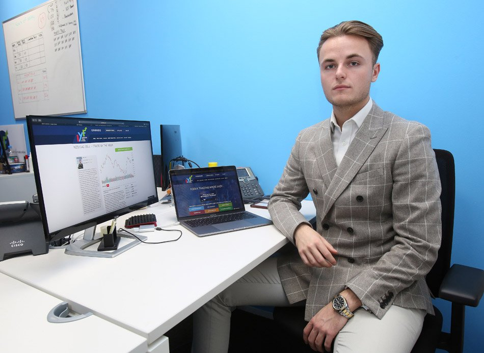 FERRARI PRESS AGENCY: Jake Lee, 20, pictured, has built a ?2 million business within a year of dropping out of university. Jake, from Bearsted, Kent, trades in the foreign exchange market online. See Ferrari copy. Picture: Gary Stone