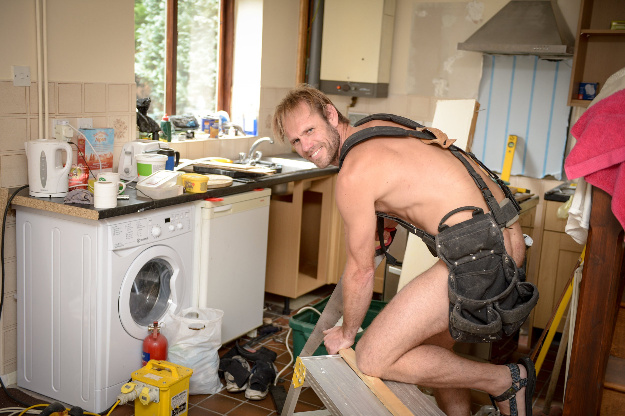 "FILE PIC - Naturist Rob Jenner renovating his house See National News story NNnaked.A naturist, dubbed the 'Naked Carpenter' for doing up his house in the buff, exposed himself while working as a delivery driver - and walked through a shopping centre in clear trousers.Robert Jenner, an ex-soldier and self-styled naturist, insisted his daring actions have never left anyone ""alarmed or shocked"" - despite walking past a playground with his manhood in clear view.But the 43-year-old was convicted of ten counts of indecent exposure at Canterbury Crown Court.But the court decided he should be punished for 'going commando' and was found guilty of ten offences, after an 11th charge was dropped."