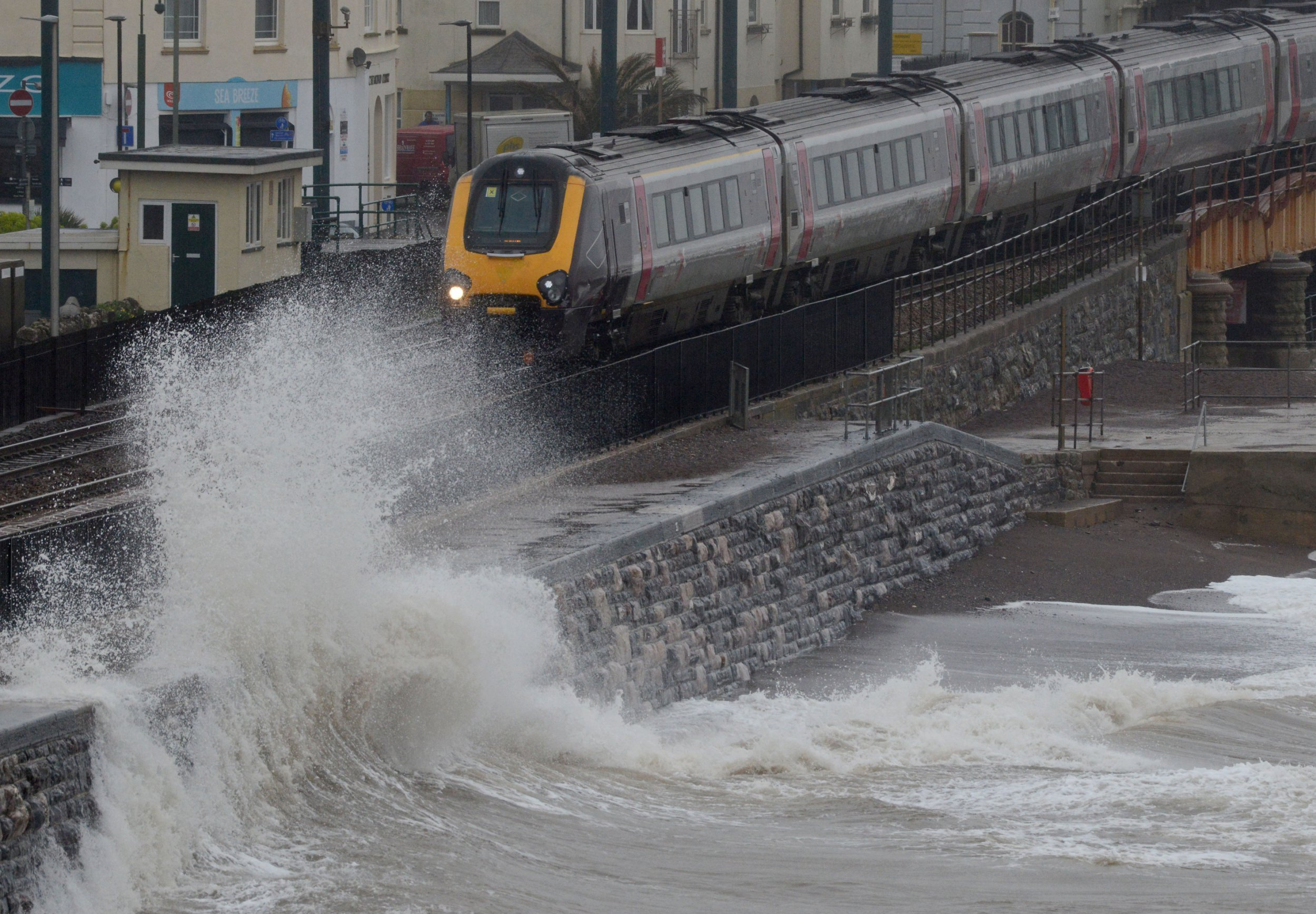 DAWLISH, ENGLAND - MARCH 12: Waves crash against the seafront and railway line on March 12, 2019 in Dawlish, United Kingdom. Met Office issues yellow warnings as Storm Gareth is forecast to bring potentially disruptive wet and windy weather which could cause travel delays and power cuts. (Photo by Finnbarr Webster/Getty Images)