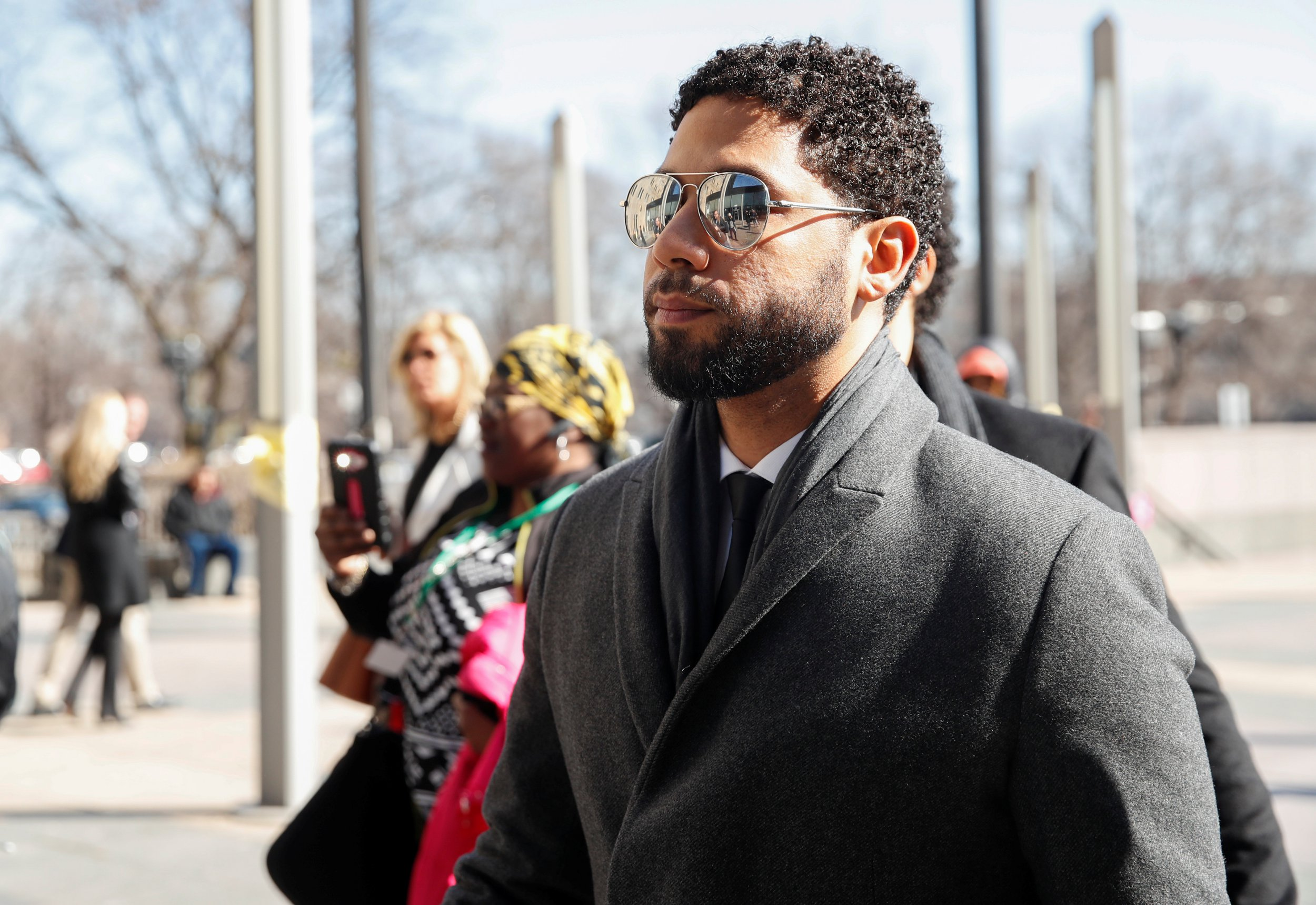 Jussie Smollett confidently struts into court hearing he didn't have to attend as he faces 16 charges
