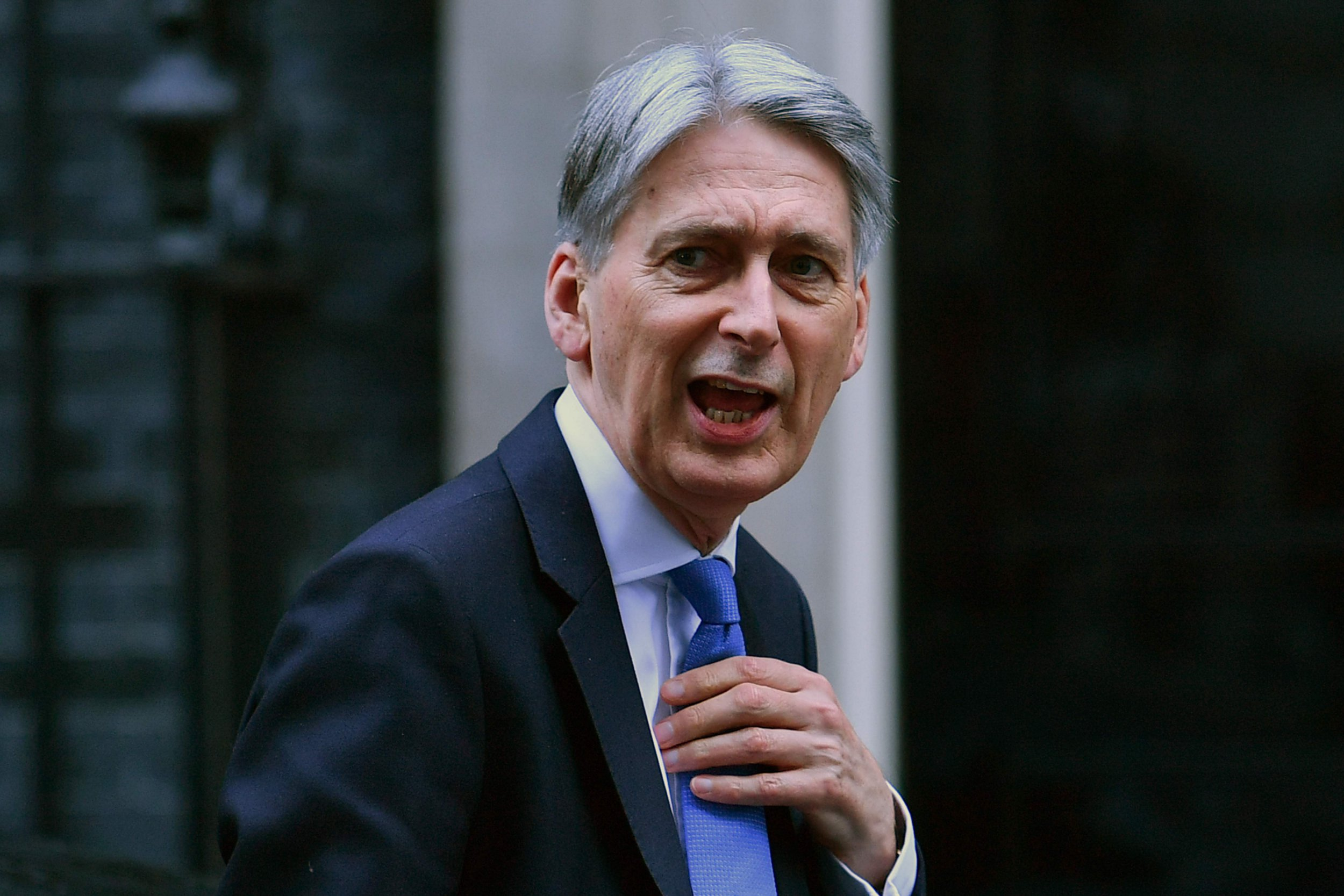 Britain's Chancellor of the Exchequer Philip Hammond arrives at 10 Downing Street in London on March 12, 2019. - British finance minister Philip Hammond on Wednesday updates the government's spending and tax plans that depend heavily on the nature of Brexit. The Spring Statement, an update on the main annual budget announcement last October, comes less than 24 hours after British MPs vote Tuesday on whether to back Prime Minister Theresa May's Brexit deal or risk a 'no deal' departure on March 29. (Photo by Ben STANSALL / AFP)BEN STANSALL/AFP/Getty Images