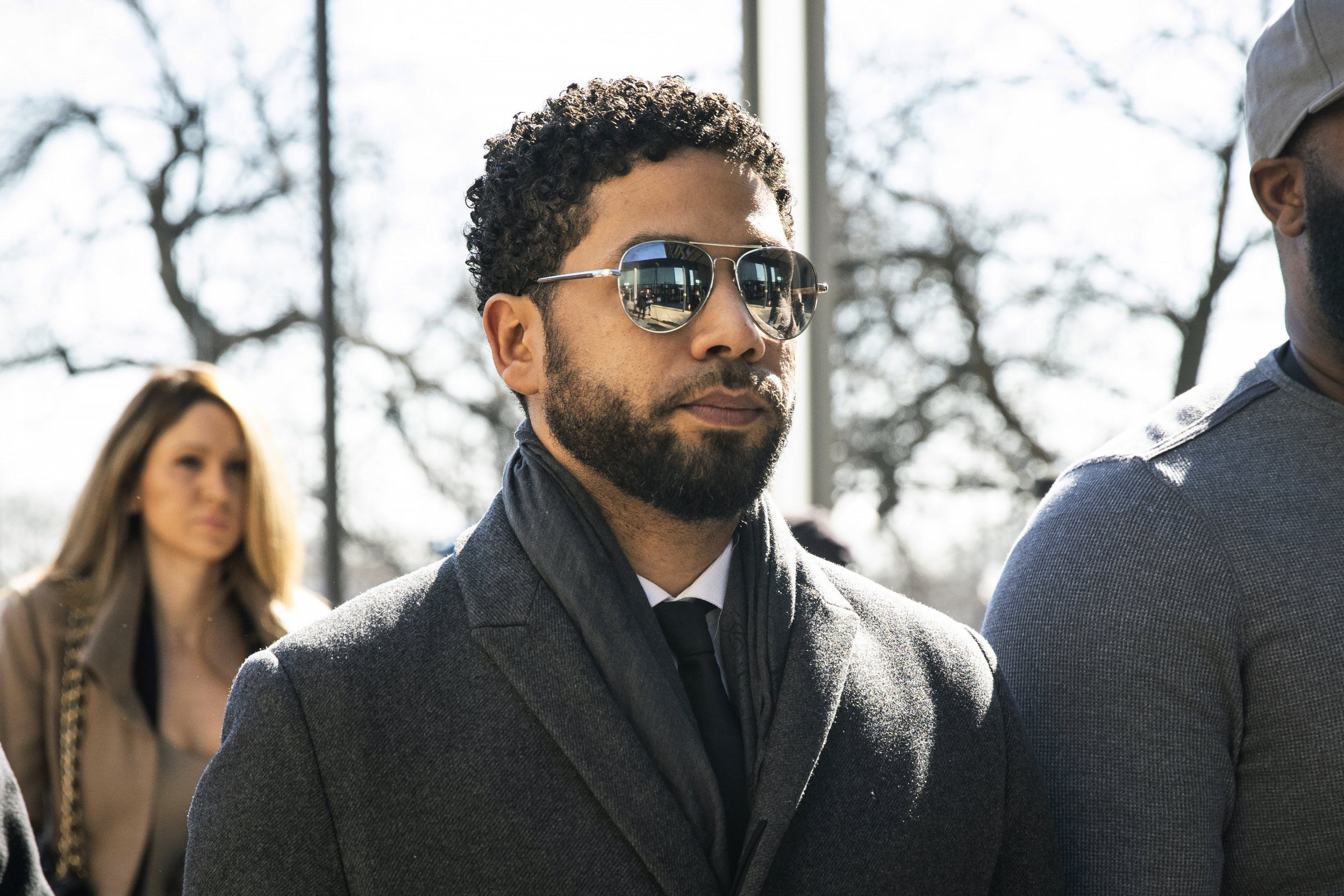 """Empire"" actor Jussie Smollett, center, arrives at Leighton Criminal Court Building for a hearing to discuss whether cameras will be allowed in the courtroom during his disorderly conduct case on Tuesday, March 12, 2019, in Chicago. A grand jury indicted Smollett last week on 16 felony counts accusing him of lying to the police about being the victim of a racist and homophobic attack by two masked men in downtown Chicago. (Ashlee Rezin/Chicago Sun-Times via AP)"
