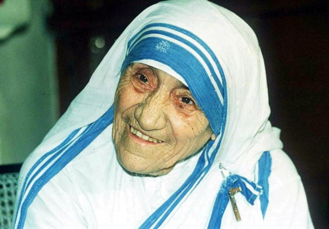 NEW DELHI, INDIA - APRIL 12: In this file picture taken, 12 April 1995, Mother Teresa smiles as she poses for photographers in Calcutta. Mother Teresa will be beatified, 19 October 2003, in a ceremony in St Peter's Square, Vatican. The beatification ceremony is the penultimate step to being canonised a saint and has been the shortest in modern history. Following the beatification, a second miracle has to be verified by the Vatican before Mother Teresa can be proclaimed a saint. AFP PHOTO (Photo credit should read STR/AFP/Getty Images)