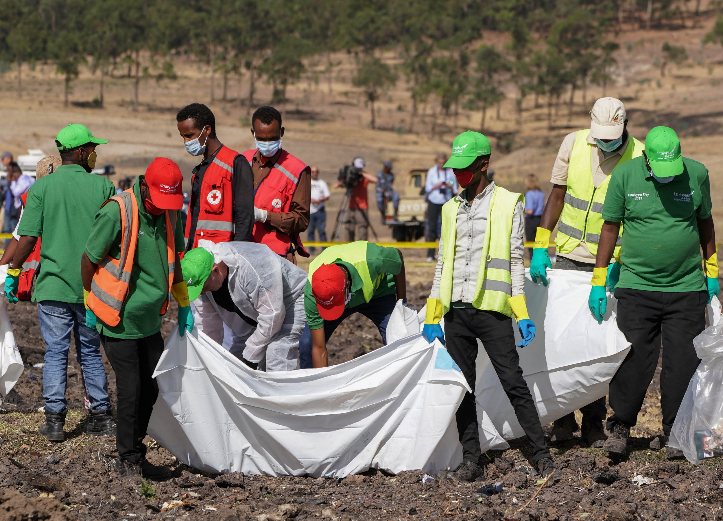 BISHOFTU, ETHIOPIA - MARCH 12: Forensics investigators and recovery teams collect personal effects and other materials from the crash site of Ethiopian Airlines Flight ET 302 on March 12, 2019 in Bishoftu, Ethiopia. All 157 passengers and crew perished after the Ethiopian Airlines Boeing 737 Max 8 Flight came down six minutes after taking off from Bole Airport. (Photo by Jemal Countess/Getty Images)