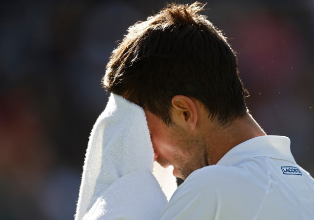 epa07432657 Novak Djokovic of Serbia wipes his face with a towel as he plays against Philipp Kohlschreiber of Germany during the BNP Paribas Open tennis tournament at the Indian Wells Tennis Garden in Indian Wells, California, USA, 12 March 2019. The men's and women's final will be played, 17 March 2019. EPA/LARRY W. SMITH
