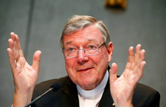 FILE PHOTO - Cardinal George Pell gestures as he talks during a news conference for the presentation of new president of Vatican Bank IOR, at the Vatican July 9, 2014. REUTERS/Tony Gentile/File Photo