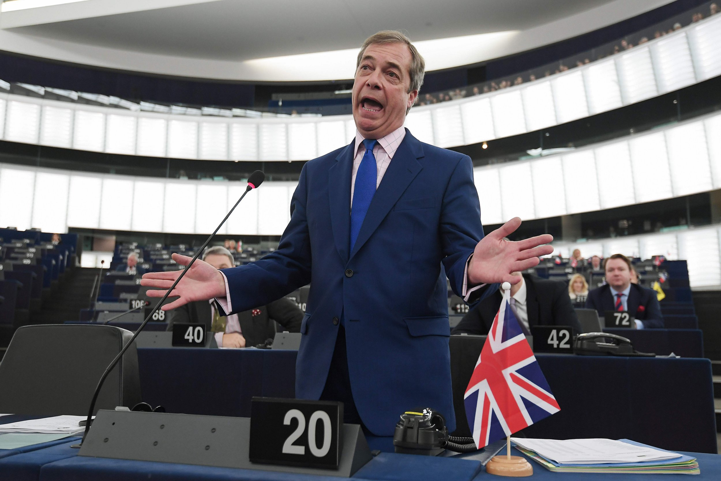 """TOPSHOT - Former UK Independence Party (UKIP) leader, Brexit campaigner and member of the European Parliament Nigel Farage gestures as he speaks during a debate on the preparation of the upcoming European Council meeting of March 21 and 22 and UKs withdrawal from the EU during a plenary session at the European Parliament on March 13, 2019 in Strasbourg, eastern France. - The European Union will have to hear from Britain how it plans to deliver a divorce deal agreement before deciding whether to delay Brexit, negotiator Michel Barnier said on March 13. """"The United Kingdom must tell us what its choice is, the clear line we're waiting for, before we even decide on an eventual extension,"""" Barnier told members of the European Parliament. (Photo by FREDERICK FLORIN / AFP)FREDERICK FLORIN/AFP/Getty Images"""