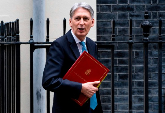 "Britain's Chancellor of the Exchequer Philip Hammond leaves from 11 Downing Street in central London on March 13, 2019, headed for the Houses of Parliament where he is set to deliver his Spring Budget update. - British MPs will vote Wednesday on whether the country should leave the EU without a deal in just over two weeks, after overwhelmingly rejecting a draft divorce agreement. The House of Commons is expected to vote against a ""no deal"" Brexit, although this could still happen on March 29 unless it can agree on what should happen instead. (Photo by Niklas HALLE'N / AFP)NIKLAS HALLE'N/AFP/Getty Images"