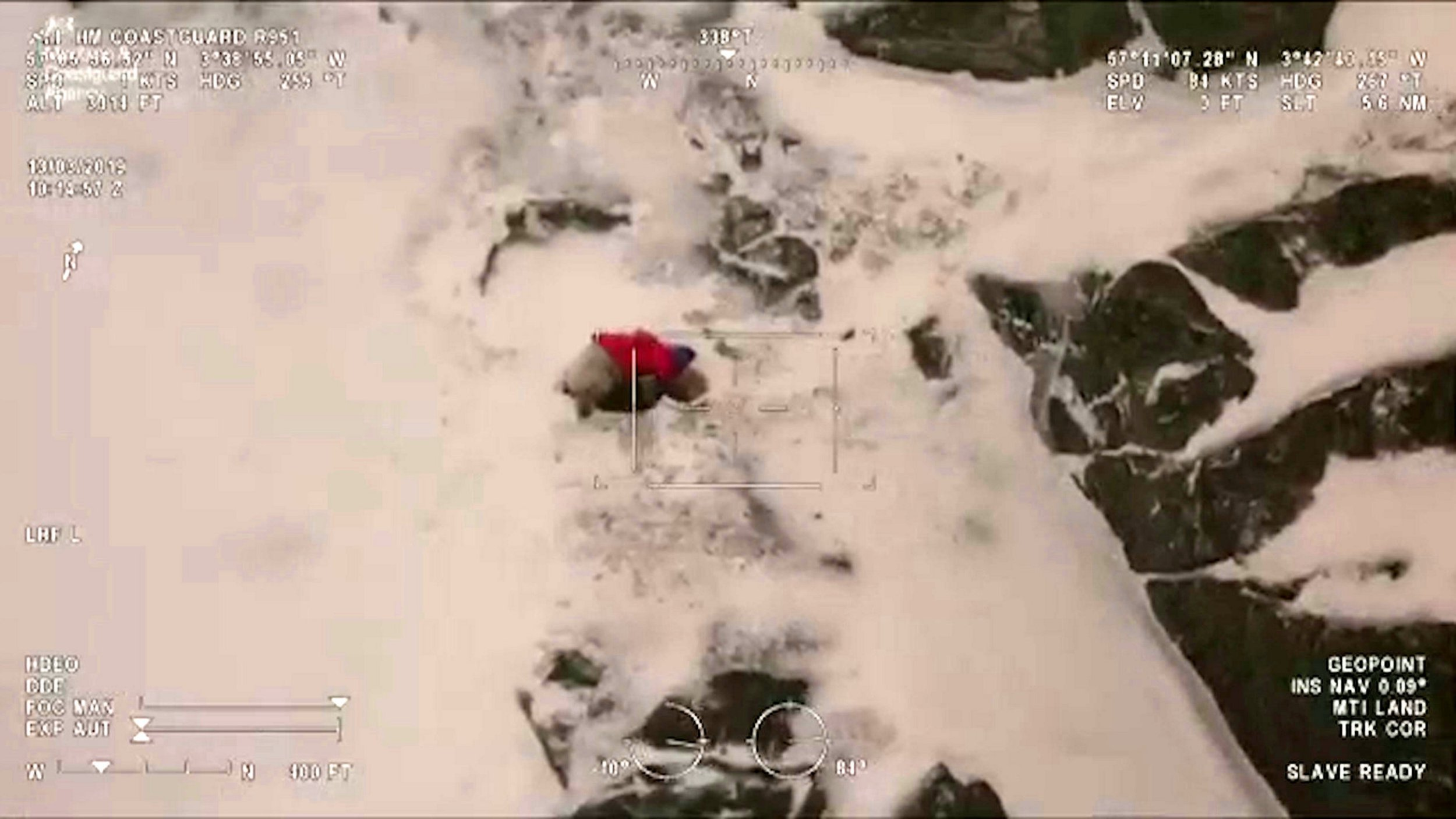 """Video grab from the incredible footage of the Inverness Coastguard helicopter rescuing a dog called Ben from Loch Avon in the Cairngorms- after the canine went missing 48 hours earlier in the bad weather of Storm Gareth .See SWNS story SWSCmountain. This is the heartwarming moment a dog was rescued by a helicopter crew - after it was stranded on a mountain in bad weather for 48 hours.Ben the dog ran off while on a trip near Loch Avon, the Cairngorms, on Monday, and got lost in the severe weather conditions of Storm Gareth.But today (Wed) Inverness Coastguard helicopter crew, who were on a training exercise, rescued Ben after the Cavachon dog was spotted on a narrow ledge.Putting the crews' skills to the test, winchmen were dropped off to collect the adorable dog which appeared to be """"terrified and cold""""."""