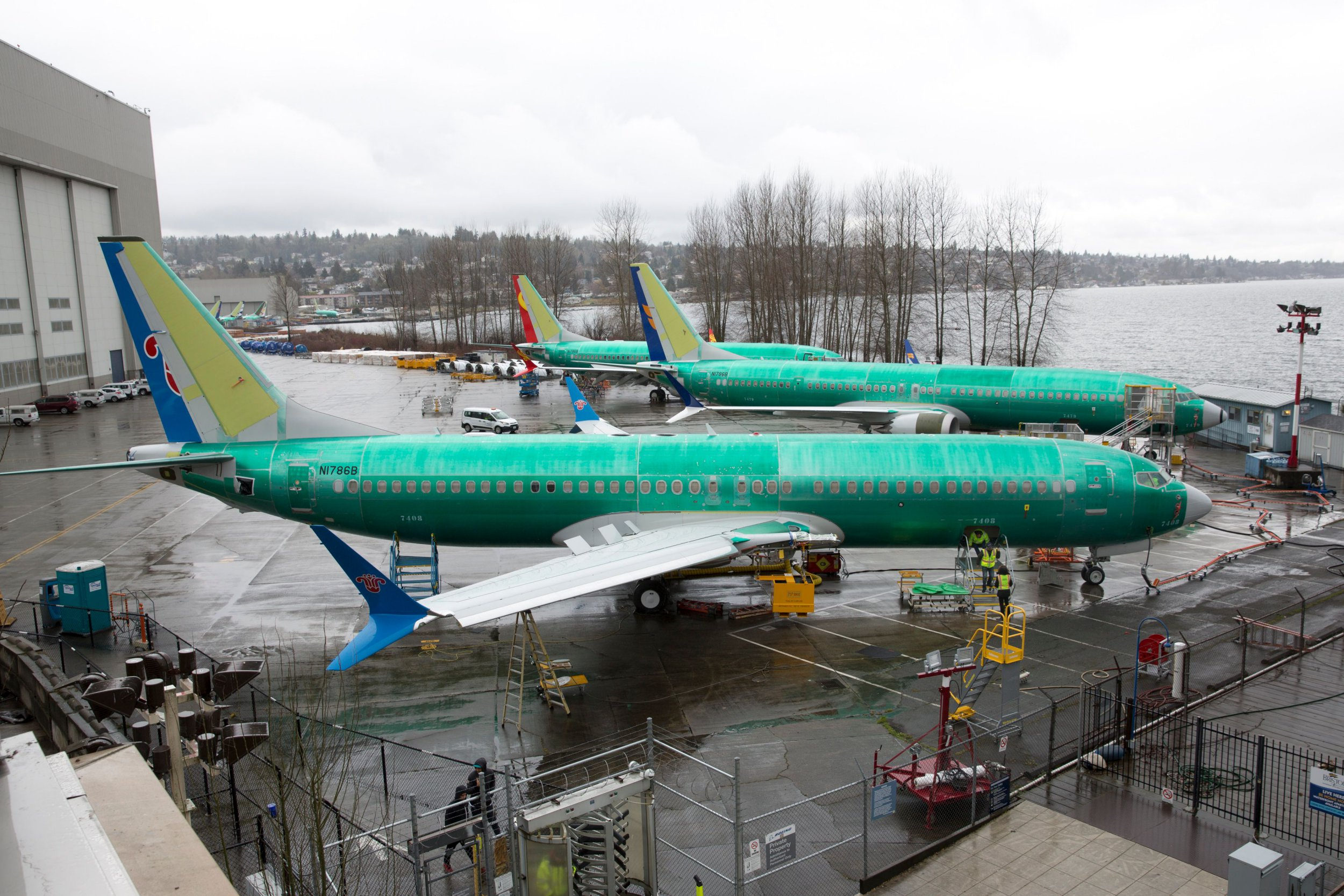"""A Boeing 737 MAX 8 for China Southern Airlines (front) is pictured at the Boeing Renton Factory in Renton, Washington on March 12, 2019. - US President Donald Trump on March 13, 2019, announced a plan to ground all Boeing 737 MAX aircraft amid intense international and political pressure following the second deadly crash in less than five months. """"We're going to be issuing an emergency order of prohibition regarding all flights of the 737 MAX 8 and 737 MAX 9,"""" Trump told reporters the White House. (Photo by Jason Redmond / AFP)JASON REDMOND/AFP/Getty Images"""