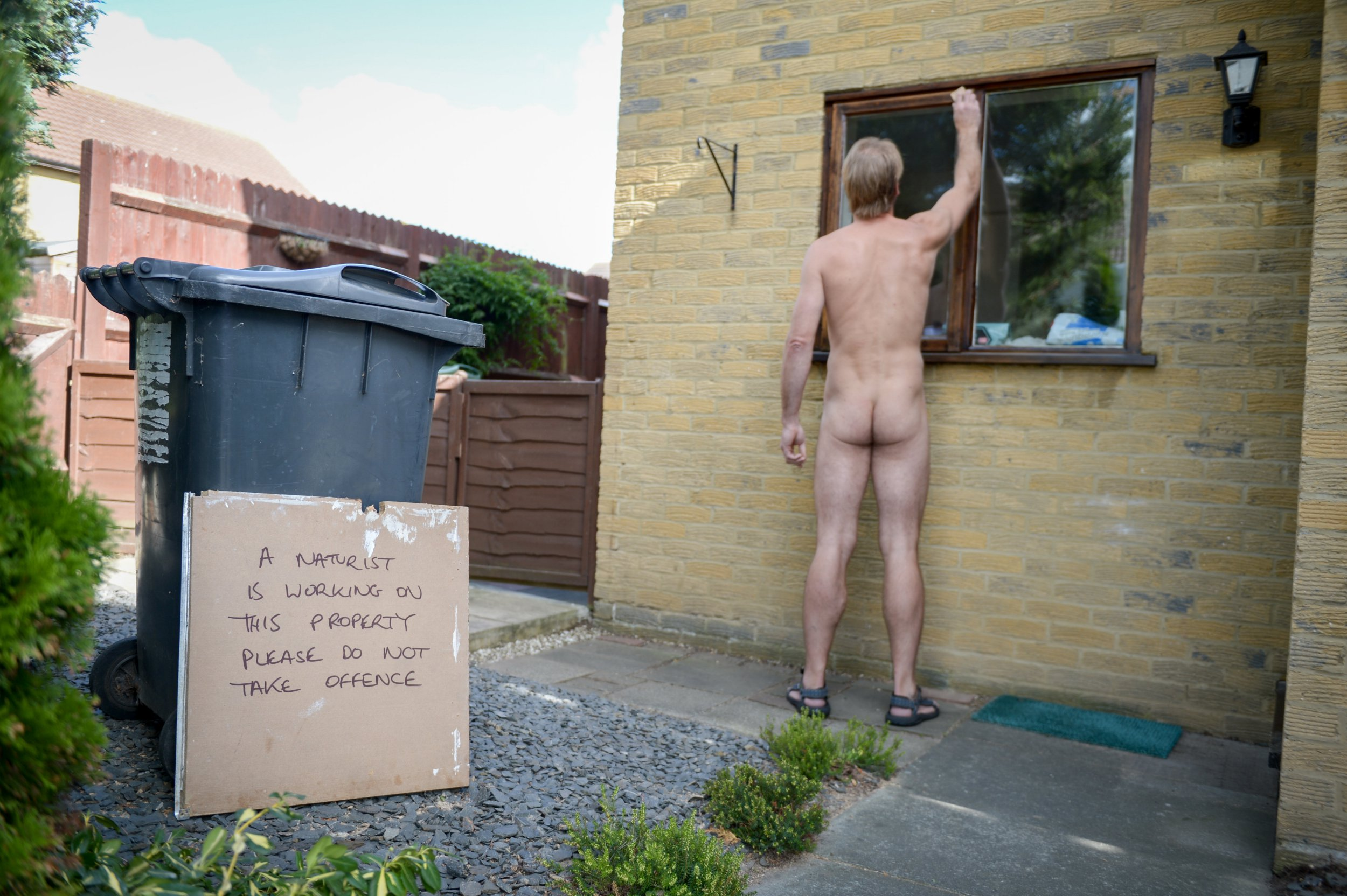 """FILE PICTURE - Naturist Rob Jenner renovating his house. A self-styled 'naked carpenter"""" has been jail for two years for flashing in public. See NATIONAL story NNnaked. Bearded Robert Jenner had paraded his manhood in front of shocked shop staff and day trippers at a park. Dressed in a smart black suit, the former soldier had told a jury at Canterbury Crown Court that he was a """"naturist"""" who was promoting his beliefs. But witnesses told how they were shocked and distressed after being confronted by Jenner delivering parcels for Hermes. And now a judge has told him that he was in reality ???an exhibitionist who revels in upsetting people???. Jenner, of Bingley Close has also been made subject to a Criminal Behaviour Order for seven years. It will mean he must wear at least one level of clothing which hides his manhood."""