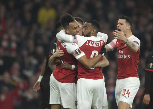 LONDON, ENGLAND - MARCH 14: Pierre-Emerick Aubameyang of Arsenal celebrates after scoring his team's first goal with team mates during the UEFA Europa League Round of 16 Second Leg match between Arsenal and Stade Rennes at Emirates Stadium on March 14, 2019 in London, United Kingdom. (Photo by TF-Images/Getty Images)