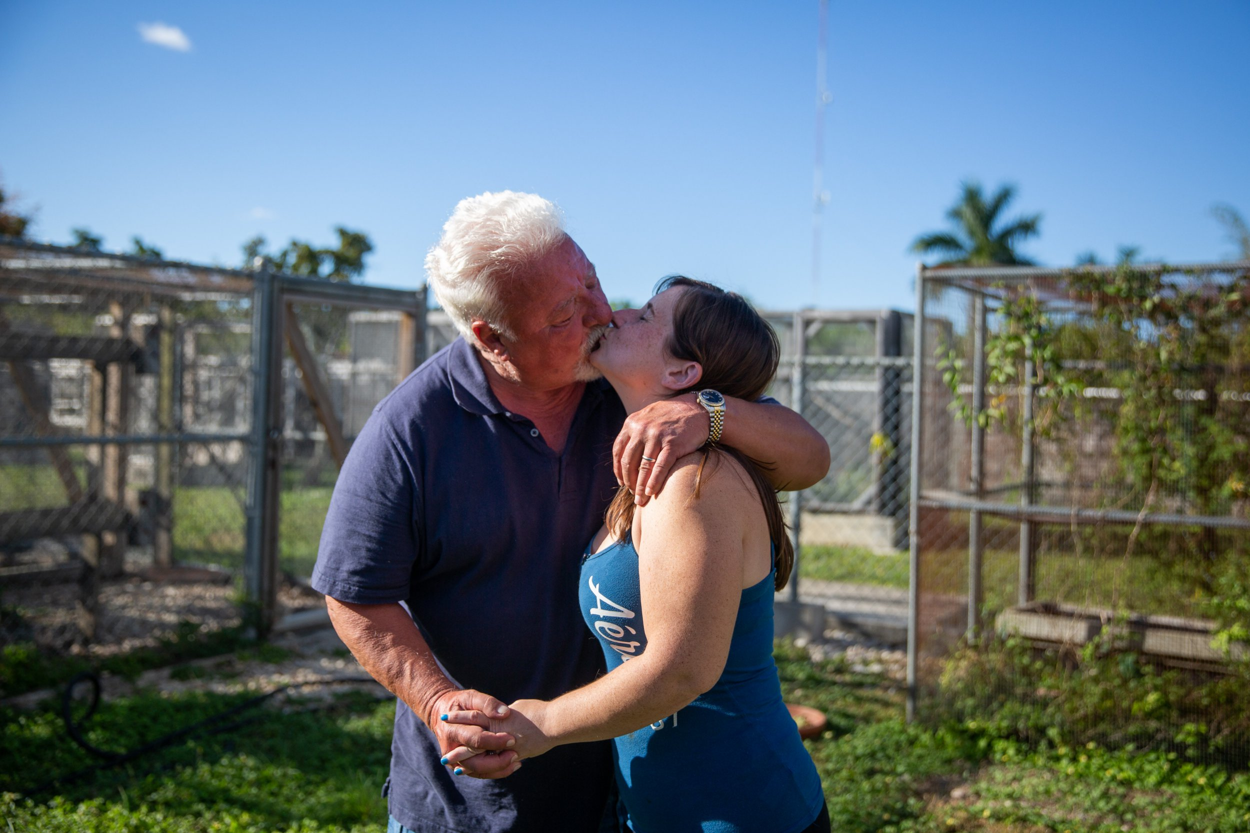 *** EXCLUSIVE - VIDEO AVAILABLE *** HOMESTEAD, FLORIDA - FEBRUARY 28: Husband and wife Tom and Stacey Crutchfield, who have a 32-year age gap, share a kiss among their reptile enclosures on February 28, 2019 in Homestead, Florida. A MARRIED couple with a 32 age gap say that their difference in age is no issue. Tom Crutchfield is 70 years old and has been with his 37-year-old beloved, Stacey, for almost four years. The couple got to know each other when Stacey began working on Tom?s reptile farm in Homestead, Florida, where the pair now live and work together. PHOTOGRAPH BY Adam Gray / Barcroft Images