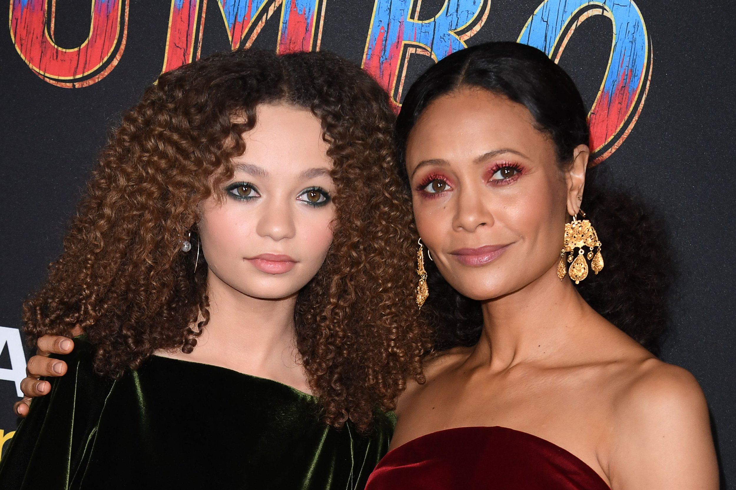 """US actress Nico Parker (L) and her mom actress Thandie Newton (R) arrive for the world premiere of Disney's """"Dumbo"""" at El Capitan theatre on March 11, 2019 in Hollywood. (Photo by Robyn Beck / AFP) (Photo credit should read ROBYN BECK/AFP/Getty Images)"""