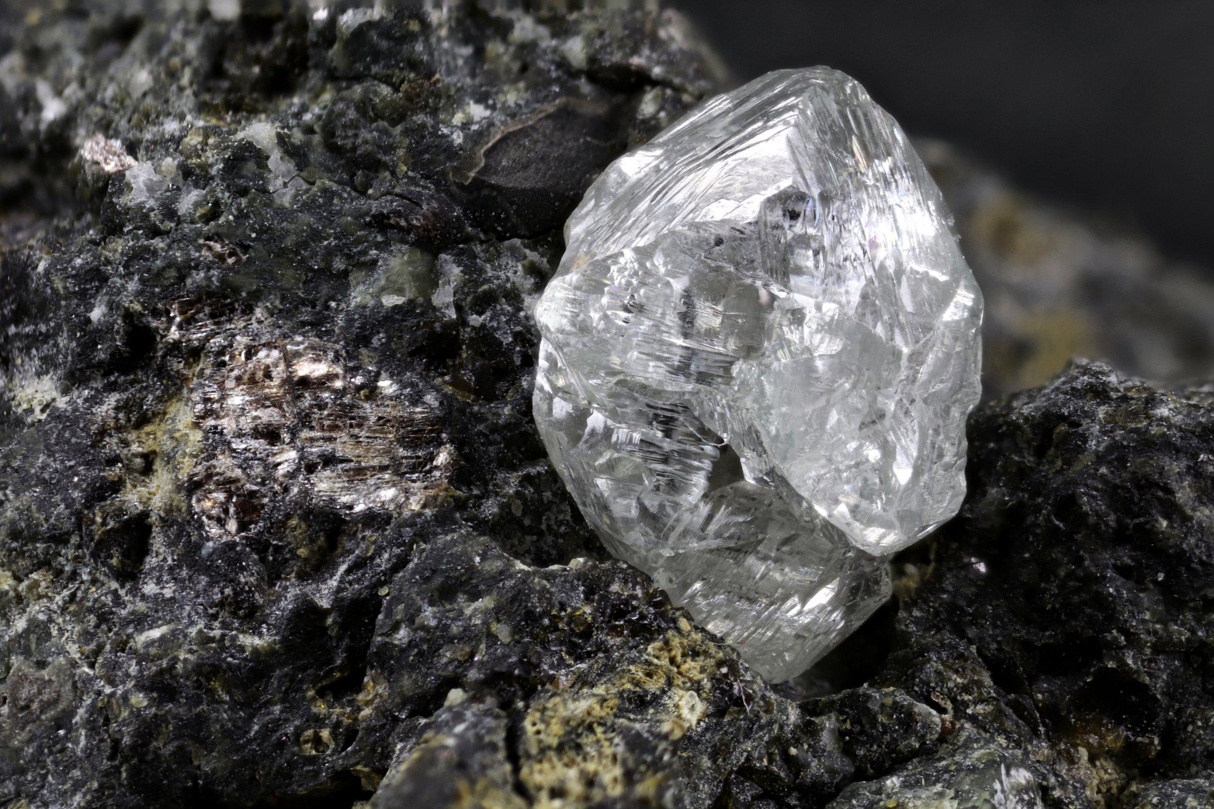 natural diamond nestled in kimberlite; Shutterstock ID 1047373015; Purchase Order: -