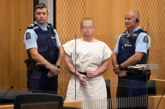 epa07441050 Brenton Tarrant (Pixelated) makes a sign to the camera during his appearance, on a charge of murder for Christchurch mosque massacre in the District Court, Christchurch, New Zealand, 16 March 2019. At least 49 people were killed by a gunman, believed to be Brenton Harrison Tarrant, and 20 more injured and in critical condition during the terrorist attacks against two mosques in New Zealand during Friday prayers on 15 March. EPA/Martin Hunter / POOL NEW ZEALAND OUT