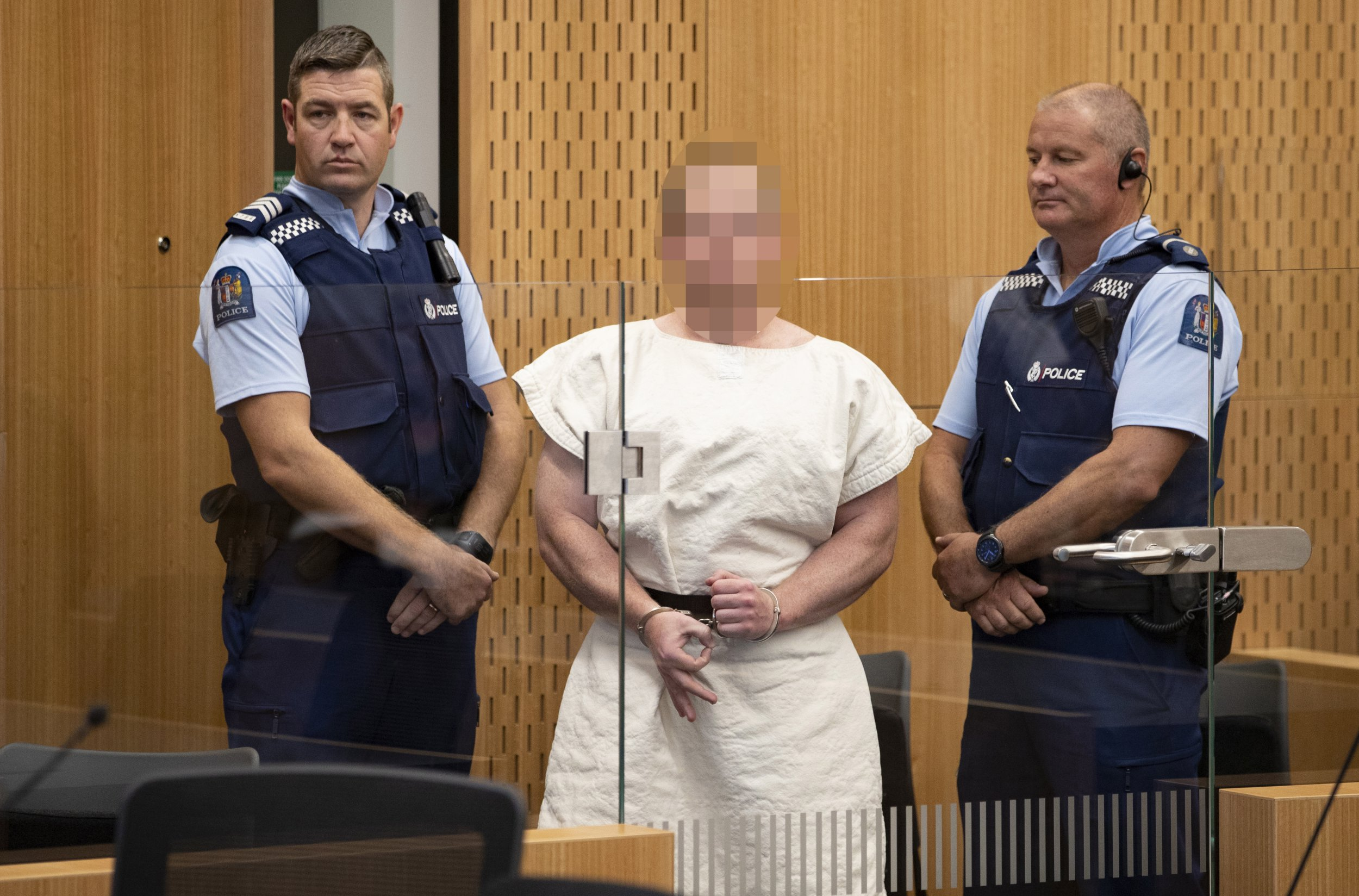 epa07441050 Brenton Tarrant (Pixelated) creates a pointer to a camera during his appearance, on a assign of murder for Christchurch mosque electrocute in a District Court, Christchurch, New Zealand, 16 Mar 2019. At slightest 49 people were killed by a gunman, believed to be Brenton Harrison Tarrant, and 20 some-more harmed and in vicious condition during a militant attacks opposite dual mosques in New Zealand during Friday prayers on 15 March. EPA/Martin Hunter / POOL NEW ZEALAND OUT