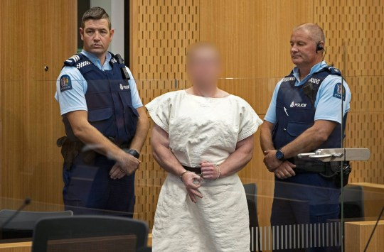 CHRISTCHURCH, NEW ZEALAND - MARCH 16: (EDITOR'S NOTE: Parts of this image have been pixelated at source to conceal the identity of the defendant due to court order.) The man charged in relation to the Christchurch massacre, Brenton Tarrant, gestures in the dock for his appearance for murder in the Christchurch District Court on March 16, 2019 in Christchurch, New Zealand. At least 49 people are confirmed dead, with more than 40 people injured following attacks on two mosques in Christchurch on Friday afternoon. 41 of the victims were killed at Al Noor mosque on Deans Avenue and seven died at Linwood mosque. Another victim died later in Christchurch hospital. Three people are in custody over the mass shootings. One man has been charged with murder. (Photo by Mark Mitchell-Pool/Getty Images)