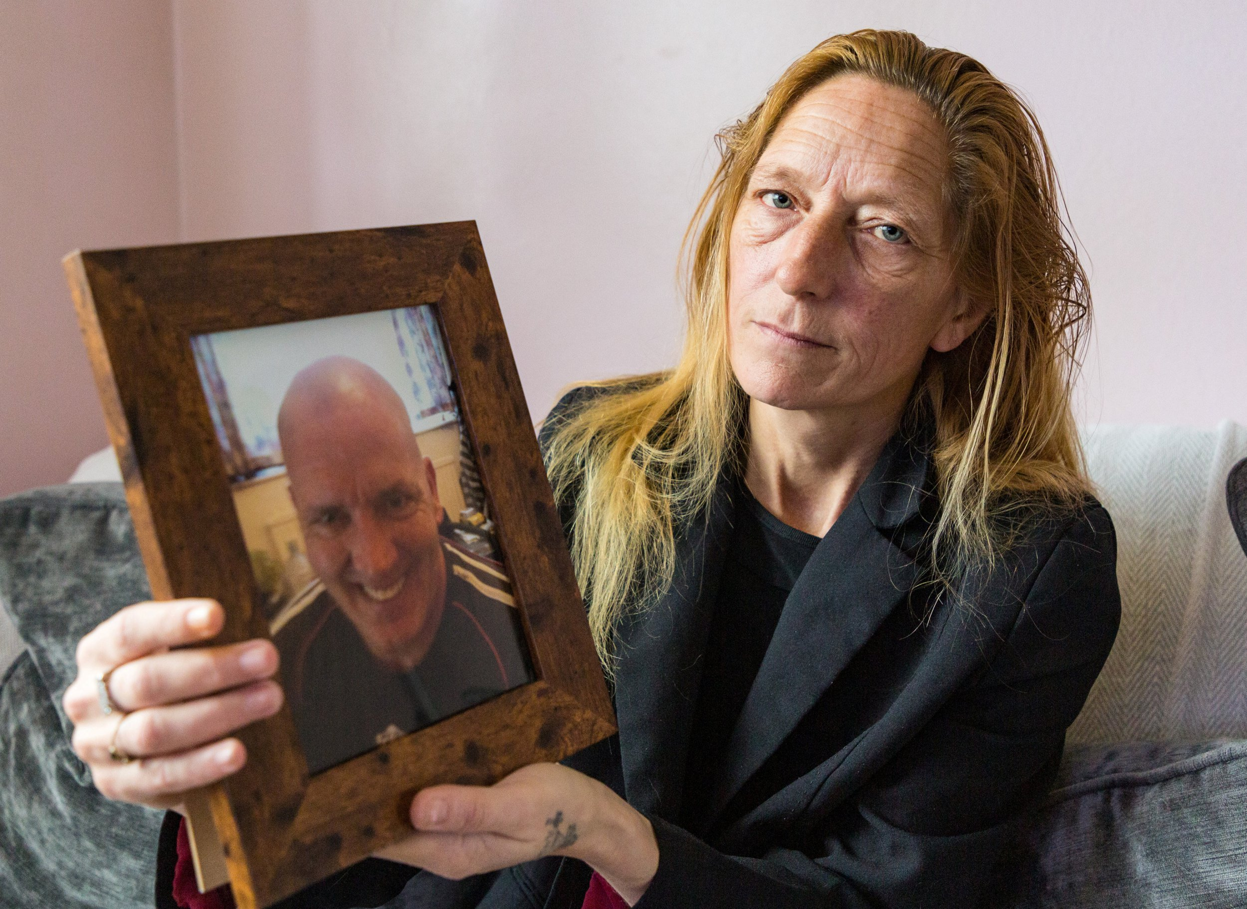 "Lisa Lane, 49, holds the only picture she has of her late partner Scott Wilkinson. See SWNS story SWOCfishing; The devastated girlfriend of a murdered fisherman has spoken out about the moment she found his 'brains scattered like blackberries' around the crime scene. Lisa Lane, 46, stumbled across the bloodied camping area after becoming worried when she hadn't heard from her partner Scott Wilkinson. Scott, 48, had been battered to death with a plank of wood by teen brothers Lenny and Shane Crawt. The pair were sentenced to life for his murder at Guildford Crown Court with a minimum term of 15 years on Tuesday. Their cousin 21-year-old cousin Charlie Smith, was convicted of manslaughter and sentenced to 13 years in prison Lisa and Scott had met and fallen in love just meters away from where the savage murder was committed. Lisa, a former cleaner, from Walton-on-Thames, Surrey, said: ""This is something that I'm never going to get over."