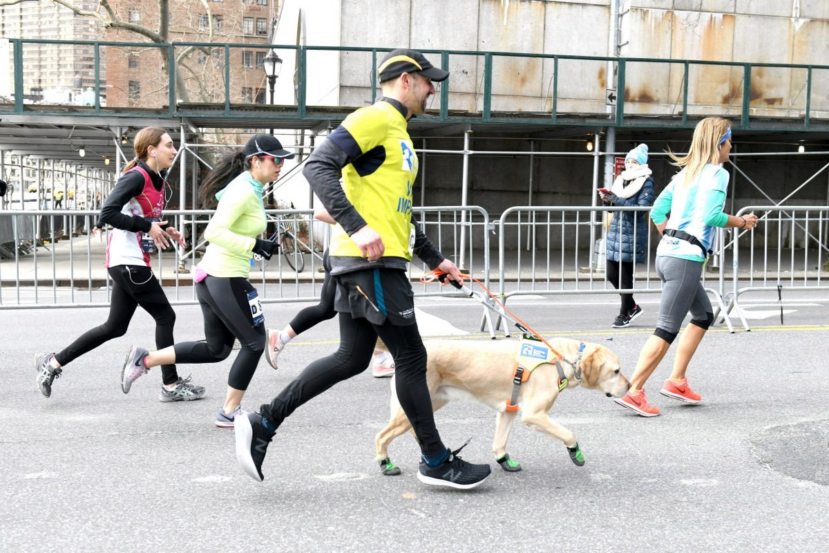 The first blind person to finish the New York City half marathon is helped by adorable guide dogs