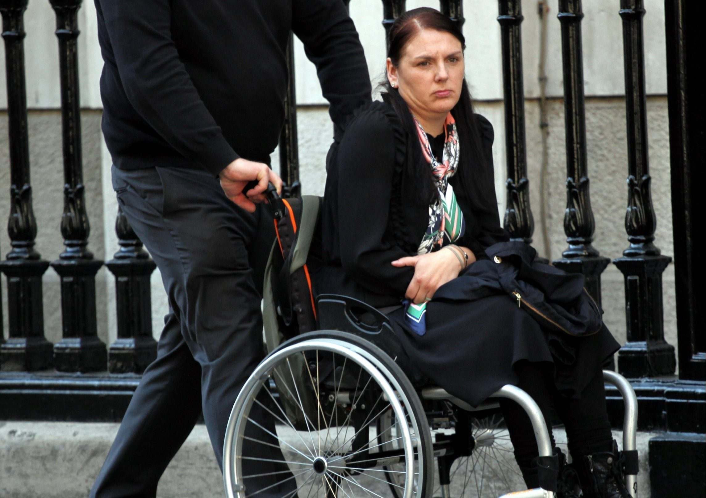 Kerry Shaw and husband Paul outside High Court during hearing in her fight for damages over back injury, March 1, 2019. Image by Champion News Service Ltd - 07914 583 378 - all first use to be considered live for payment purposes.
