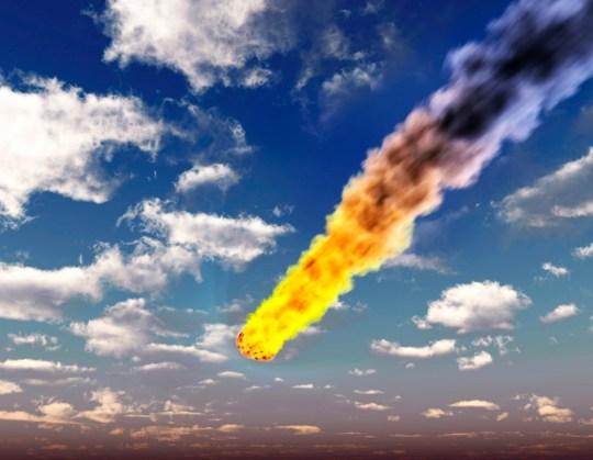 Meteorite in Earth's atmosphere. Computer artwork of a meteor burning up in Earth's atmosphere.