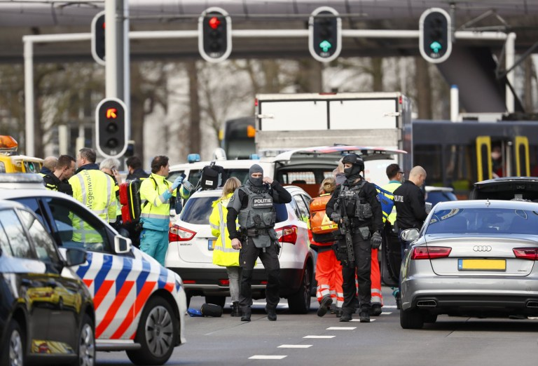 """Emergency services stand at the 24 Oktoberplace in Utrecht, on March 18, 2019 where a shooting took place. - Several people were wounded in a shooting on a tram in the Dutch city of Utrecht on March 18, police said, with local media reporting counter-terrorism police at the scene. """"Shooting incident... Several injured people reported. Assistance started,"""" the Utrecht police Twitter account said. """"It is a shooting incident in a tram. Several trauma helicopters have been deployed to provide help."""" (Photo by Robin van Lonkhuijsen / ANP / AFP) / Netherlands OUTROBIN VAN LONKHUIJSEN/AFP/Getty Images"""