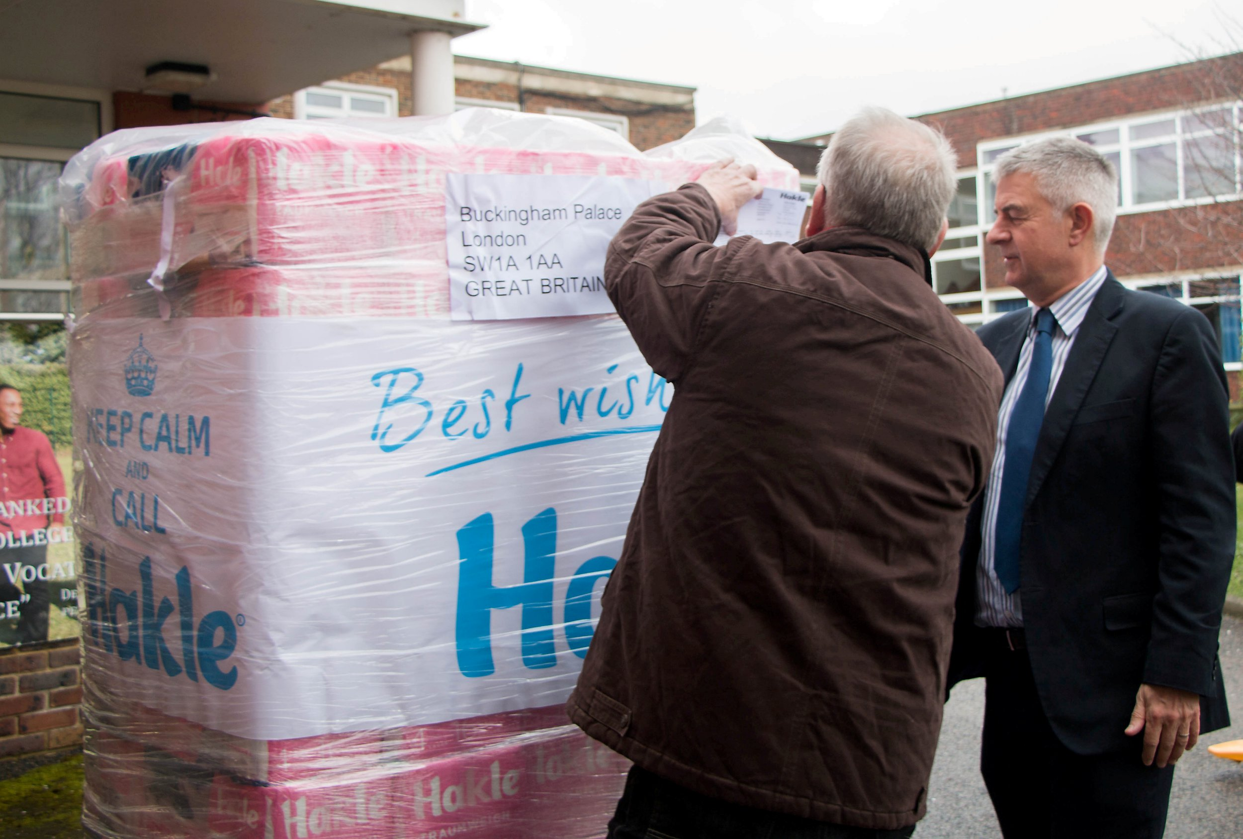 """A thousand premium toilet rolls are donated to a secondary school - after they were rejected by the queen. See National News story NNrolls; German company Hakle sent 90 packs of bog roll to Buckingham Palace to ensure the monarch has access to one of life's necessities in case of a 'no deal' Brexit shortage. After the palette was turned away by security due to safety fears, a staff member of the Dusseldorf based company suggested they should gift to Woodcote High School, based in Coulsdon, south London, where her brother Peter Mack works as Deputy Head. Peter said: """"It's been a slightly confusing series of events, but in the end we've ended up with a helpful stock of high quality loo roll."""