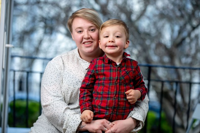 PIC FROM Caters News - (PICTURED:Emily Smith, 23, from Bognor Regis, West Sussex, with son Jaxson, 3) - A lifesaving mum has detected her toddlers eye cancer after spotting a bizarre white spot on his photograph. Emily Smith, 23, from Bognor Regis, West Sussex, took a close-up photo of her son, Jaxson, and noticed a strange grey area behind one of his pupils. Following the discovery, the mum of one rushed to take Jaxson, then 11 months old, to the doctors where he was then referred onto eye specialists.SEE CATERS COPY