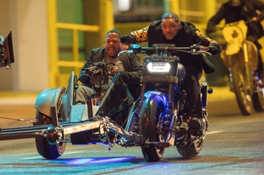 Atlanta, GA - *EXCLUSIVE* Will Smith and Martin Lawrence ride thru Miami on a tandem motorcycle with a side mounted mini-gun (notice the flames of the bullets) while filming a scene for 'Bad Boys for Life' in Atlanta. Pictured: Martin Lawrence, Will Smith BACKGRID USA 20 MARCH 2019 USA: +1 310 798 9111 / usasales@backgrid.com UK: +44 208 344 2007 / uksales@backgrid.com *UK Clients - Pictures Containing Children Please Pixelate Face Prior To Publication*
